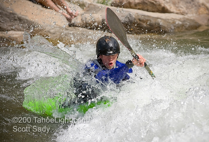 in the junior freestyle kayak division at the Reno River Festival.