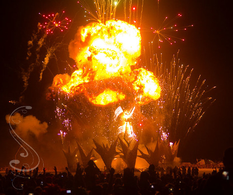 A giant ball of flame is the ignition source for the man during the culmination of the Burning Man Project in the black rock desert on Saturday Night.