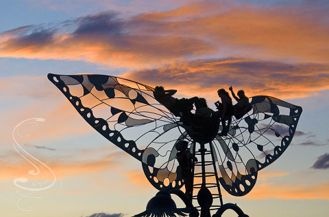 Enjoying the sunset at burning man from atop a giant metal sculpture of butterfly wings. Again, anyone with names for these installations please leave a comment so I can post them.