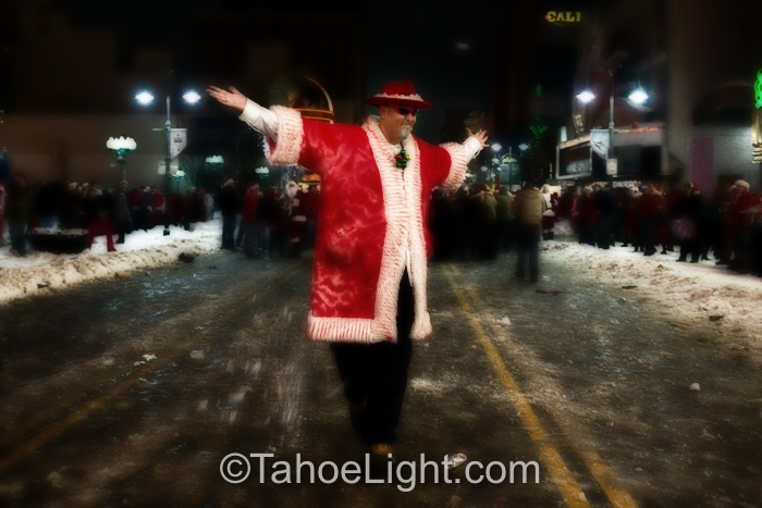 "Pimp Santa strolling the ""Gauntlet of death,"" between opposing fields of snowball throwers under the Reno Arch."