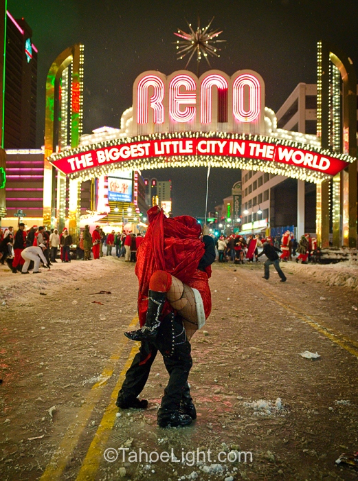 A little santa love under the Reno Arch during the Santa pub crawl. Keep in mind, the snowball fight has begun and this couple is getting pelted right and left. Some people like it rough I guess.