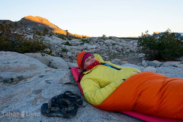 woman in sleeping bag in mountains