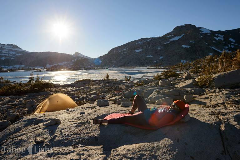 photo of backpacker camp at lake